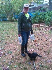 Emily refilling bunny bottles.